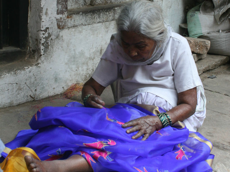 Old Lady Sewing a Garment