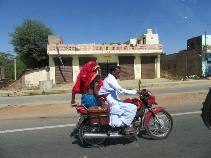Indian couple riding motorcycle