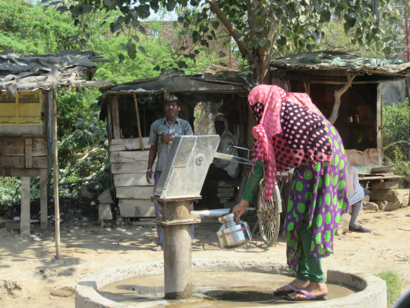 Woman Pumping Hand Pump
