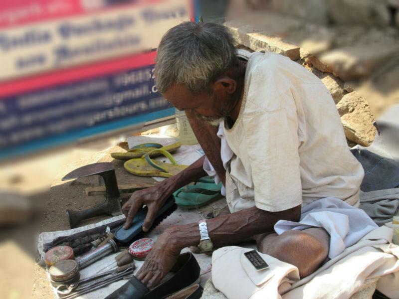 An Elderly Cobbler at Work
