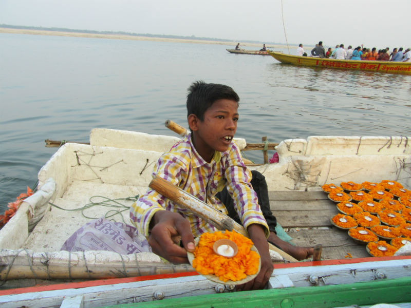 Little Boy Selling Flower Candles